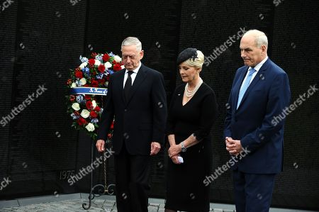 General John Kelly (R), White House Chief of Staff, US Secretary of Defense James Mattis (L), and Cindy McCain (C), wife of late Senator John McCain, lay a ceremonial wreath honoring all whose lives were lost during the Vietnam War at the Vietnam Veterans Memorial in Washington D.C., 01 September 2018 after attending a  memorial service for John McCain.  John McCain died 25 August, 2018 from brain cancer at his ranch in Sedona, Arizona, USA. He was a veteran of the Vietnam War, served two terms in the US House of Representatives, and was elected to five terms in the US Senate. McCain also ran for president twice, and was the Republican nominee in 2008.