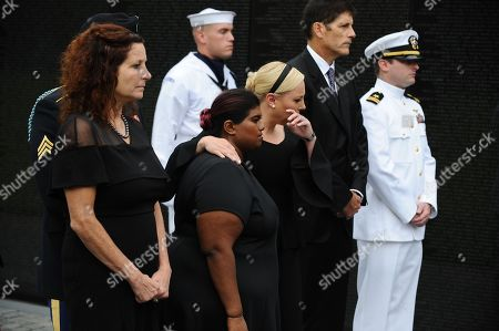 Bridget McCain  (3-L), and Meghan McCain (3-R) hug while US Secretary of Defense James Mattis, General John Kelly, White House Chief of Staff and Cindy McCain, wife of late Senator John McCain (all not pictured), lay a ceremonial wreath honoring all whose lives were lost during the Vietnam War at the Vietnam Veterans Memorial in Washington D.C., 01 September 2018 after attending a  memorial service for John McCain.  John McCain died 25 August, 2018 from brain cancer at his ranch in Sedona, Arizona, USA. He was a veteran of the Vietnam War, served two terms in the US House of Representatives, and was elected to five terms in the US Senate. McCain also ran for president twice, and was the Republican nominee in 2008.