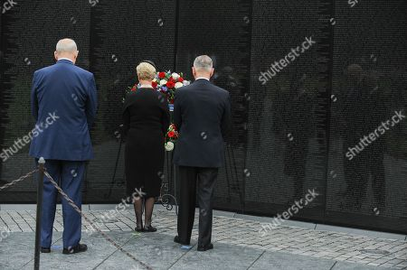 General John Kelly (L), White House Chief of Staff, US Secretary of Defense James Mattis (R), and Cindy McCain (C), wife of late Senator John McCain, lay a ceremonial wreath honoring all whose lives were lost during the Vietnam War at the Vietnam Veterans Memorial in Washington D.C., 01 September 2018 after attending a  memorial service for John McCain.  John McCain died 25 August, 2018 from brain cancer at his ranch in Sedona, Arizona, USA. He was a veteran of the Vietnam War, served two terms in the US House of Representatives, and was elected to five terms in the US Senate. McCain also ran for president twice, and was the Republican nominee in 2008.
