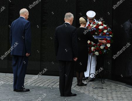 General John Kelly (L), White House Chief of Staff, US Secretary of Defense James Mattis (2-L), and Cindy McCain (2-R), wife of late Senator John McCain, lay a ceremonial wreath honoring all whose lives were lost during the Vietnam War at the Vietnam Veterans Memorial in Washington D.C., 01 September 2018 after attending a  memorial service for John McCain.  John McCain died 25 August, 2018 from brain cancer at his ranch in Sedona, Arizona, USA. He was a veteran of the Vietnam War, served two terms in the US House of Representatives, and was elected to five terms in the US Senate. McCain also ran for president twice, and was the Republican nominee in 2008.