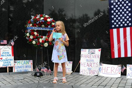 Eliana Duy, aged eight from Florida, stands in front of the wreath that U.S. Secretary of Defense James Mattis, General John Kelly, White House Chief of Staff and Cindy McCain, wife of late Senator John McCain, lay a ceremonial wreath honoring all whose lives were lost during the Vietnam War at at the Vietnam Veterans Memorial in Washington D.C., 01 September 2018 after attending a  memorial service for John McCain.  John McCain died 25 August, 2018 from brain cancer at his ranch in Sedona, Arizona, USA. He was a veteran of the Vietnam War, served two terms in the US House of Representatives, and was elected to five terms in the US Senate. McCain also ran for president twice, and was the Republican nominee in 2008.