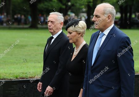 General John Kelly (R), White House Chief of Staff, US Secretary of Defense James Mattis (L), and Cindy McCain (C), wife of late Senator John McCain, depart after lay a ceremonial wreath honoring all whose lives were lost during the Vietnam War at the Vietnam Veterans Memorial in Washington D.C., 01 September 2018 after attending a  memorial service for John McCain.  John McCain died 25 August, 2018 from brain cancer at his ranch in Sedona, Arizona, USA. He was a veteran of the Vietnam War, served two terms in the US House of Representatives, and was elected to five terms in the US Senate. McCain also ran for president twice, and was the Republican nominee in 2008.