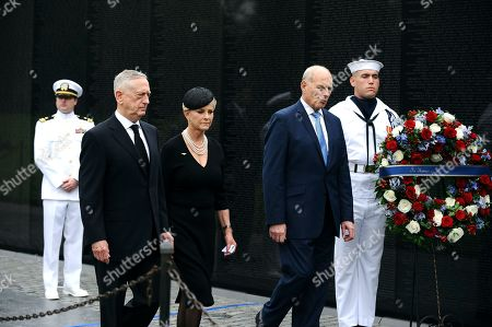 US Secretary of Defense James Mattis (2-L), General John Kelly (2-R), White House Chief of Staff and Cindy McCain (C), wife of late Senator John McCain, arrive to lay a ceremonial wreath honoring all whose lives were lost during the Vietnam War at the Vietnam Veterans Memorial in Washington D.C., 01 September 2018 after attending a  memorial service for John McCain.  John McCain died 25 August, 2018 from brain cancer at his ranch in Sedona, Arizona, USA. He was a veteran of the Vietnam War, served two terms in the US House of Representatives, and was elected to five terms in the US Senate. McCain also ran for president twice, and was the Republican nominee in 2008.