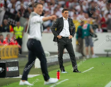 Stuttgart's coach Tayfun Korkut (R) reacts during the German Bundesliga soccer match between VfB Stuttgart and FC Bayern Munich in Stuttgart, Germany, 01 September 2018.