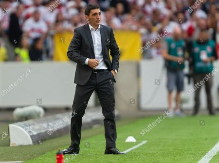 Stock Photo of Stuttgart's head coach Tayfun Korkut reacts  during the German Bundesliga soccer match between VfB Stuttgart and Bayern Munich in Stuttgart, Germany, 01 September 2018.