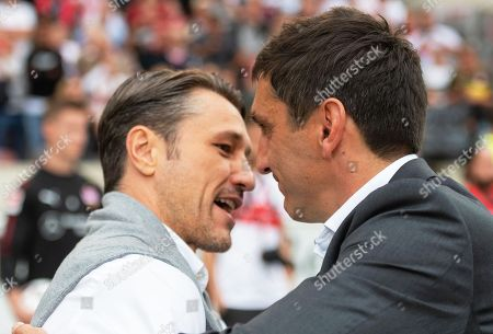 Stock Picture of Bayern Munich's head coach Niko Kovac (L) greets Stuttgart's coach Tayfun Korkut (R) prior to the German Bundesliga soccer match between VfB Stuttgart and Bayern Munich in Stuttgart, Germany, 01 September 2018.