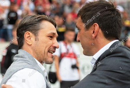 Bayern Munich's head coach Niko Kovac (L) greets Stuttgart's coach Tayfun Korkut (R) prior to the German Bundesliga soccer match between VfB Stuttgart and Bayern Munich in Stuttgart, Germany, 01 September 2018.