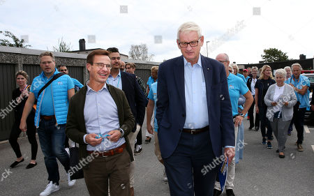 Stock Photo of Moderate Party leader Ulf Kristersson (L) and former party leader, Prime Minister and Foreign Minister Carl Bildt (R) campaigning in a residential area of Stockholm, Sweden, 01 September 2018. The Swedish general elections will be held in Sweden on 09 September 2018.