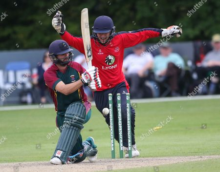 Waringstown vs Merrion. Waringstown wicketkeeper Marcus McLean celebrates Merrion's Tyrone Kane being bowled out by Lee Nelson