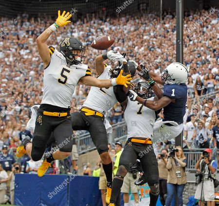 Appalachian State defenders Thomas Hennigan (5), Corey Sutton (2) and Josh Thomas (7), break up a pass intended for Penn State's KJ Hamler (1) in the end zone during the first half of an NCAA college football game in State College, Pa