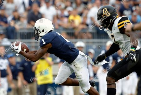 Penn State's KJ Hamler (1) makes a catch in front of Appalachian State's Josh Thomas (7) during the second half of an NCAA college football game in State College, Pa., . Penn State won 45-38 in overtime