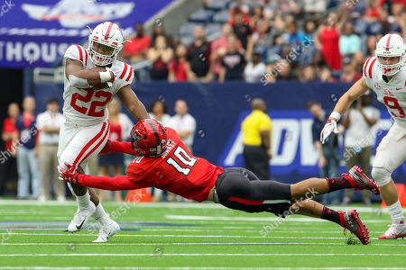 Mississippi Rebels running back Scottie Phillips (22) runs past Texas Tech Red Raiders defensive back John Bonney (10) during the first quarter during Advocare Texas Kickoff between the Ole Miss Rebels and the Texas Tech Red Raiders at NRG Stadium in Houston, TX