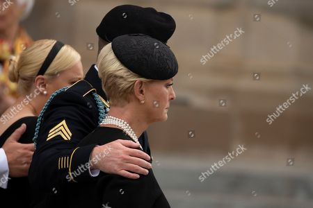 Stock Photo of Cindy McCain and Jimmy McCain look on as a Military Honor Guard carrying the casket of late Senator John McCain, Republican of Arizona, exits the National Cathedral after a funeral service at the National Cathedral in Washington, DC.