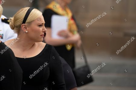 Meghan McCain looks on as a Military Honor Guard carrying the casket of late Senator John McCain, Republican of Arizona, exits the National Cathedral after a funeral service at the National Cathedral in Washington, DC.