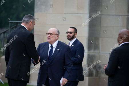 Lawyer for United States President Trump, Rudy Giuliani, right, greets Ukrainian boxer Wladimir Klitschko prior to a funeral service for late Senator John McCain, Republican of Arizona, at the National Cathedral in Washington, DC.