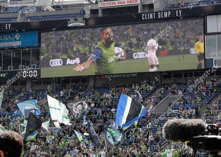Seattle Sounders forward Clint Dempsey is shown on a video display, during a pre-match ceremony in his honor in Seattle after he announced his retirement from professional soccer earlier in the week