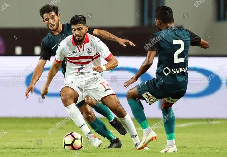Zamalek's Ferjani Sassi (C) in action against ENPPI players Hamdy Fathy (L) and Ali Fawzi (R) during the Egyptian Premier League soccer match between Zamalek SC and ENPPI SC in Cairo, Egypt, 01 September 2018.