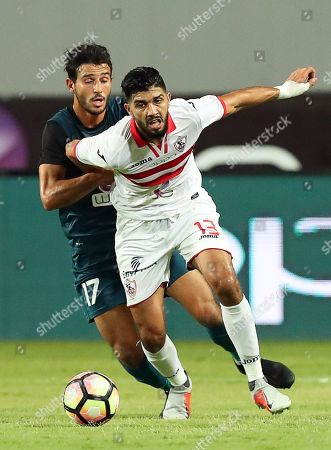 Zamalek's Ferjani Sassi (R) in action against ENPPI players Hamdy Fathy (L) during the Egyptian Premier League soccer match between Zamalek SC and ENPPI SC in Cairo, Egypt, 01 September 2018.
