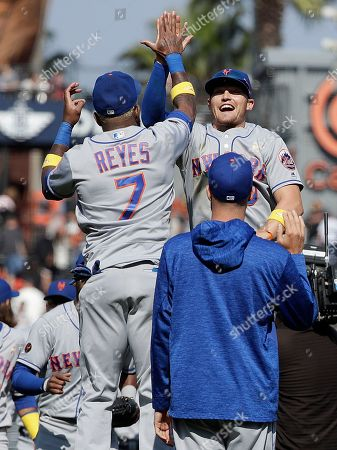 New York Mets' Jose Reyes (7) and Brandon Nimmo celebrate after a baseball game against the San Francisco Giants in San Francisco, . The Mets won 2-1 in 11 innings