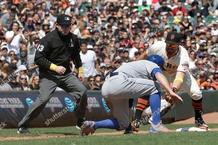 Todd Frazier, Evan Longoria. New York Mets' Todd Frazier, center, is tagged out by San Francisco Giants third baseman Evan Longoria, right, as umpire Mike Estabrook (83) watches during the sixth inning of a baseball game in San Francisco