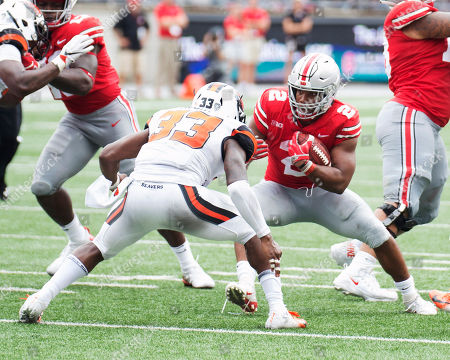 Ohio State Buckeyes running back J.K. Dobbins (2) goes one on one with Oregon State Beavers safety Jalen Moore (33) at the NCAA football game between the Oregon State Beavers & Ohio State Buckeyes at Ohio Stadium in Columbus, Ohio