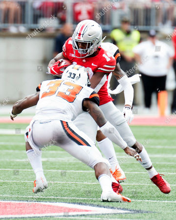Ohio State Buckeyes wide receiver K.J. Hill (14) goes one on one with Oregon State Beavers safety Jalen Moore (33) at the NCAA football game between the Oregon State Beavers & Ohio State Buckeyes at Ohio Stadium in Columbus, Ohio