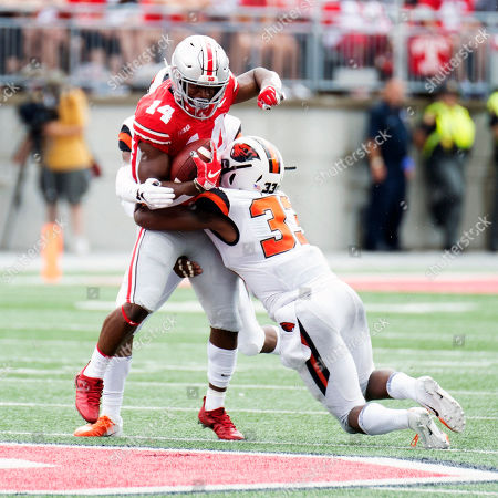 Oregon State Beavers safety Jalen Moore (33) hits Ohio State Buckeyes wide receiver K.J. Hill (14)at the NCAA football game between the Oregon State Beavers & Ohio State Buckeyes at Ohio Stadium in Columbus, Ohio