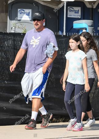 Stock Image of Adam Sandler with his daughters Sadie Sandler and Sunny Sandler