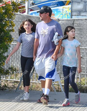 Stock Picture of Adam Sandler with his daughters Sadie Sandler and Sunny Sandler