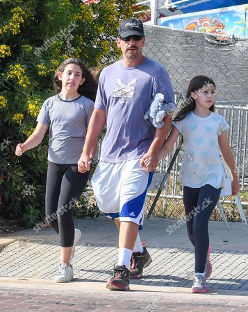 Stock Picture of Adam Sandler with his daughters Sadie and Sunny