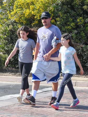 Stock Photo of Adam Sandler with his daughters Sadie Sandler and Sunny Sandler