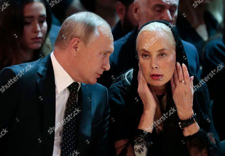 Russian President Vladimir Putin (L) speaks with widow Nelli Kobzon (R) during a funeral ceremony of the Soviet and Russian singer Iosif Kobzon at Tchaikovsky concert hall in Moscow, Russia, 02 September 2018. Iosif Kobzon, a leader of Soviet pop singer school, compared to Frank Sinatra and known also for his charity activity and as a public figure, has died at the age of 81 on 30 August 2018.