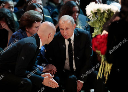 Russian President Vladimir Putin speaks with Iosif Kobzon's son Maxim Kobzon (L) and their friend, first female cosmonaut Valentina Tereshkova (2-L) during a funeral ceremony of the Soviet and Russian singer Iosif Kobzon at Tchaikovsky concert hall in Moscow, Russia, 02 September 2018. Iosif Kobzon, a leader of Soviet pop singer school, compared to Frank Sinatra and known also for his charity activity and as a public figure, has died at the age of 81 on 30 August 2018.