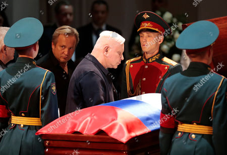Russian showman and singer Boris Moiseyev (C) pays his respect at the coffin during a funeral ceremony of the Soviet and Russian singer Iosif Kobzon at Tchaikovsky concert hall in Moscow, Russia, 02 September 2018. Iosif Kobzon, a leader of Soviet pop singer school, compared to Frank Sinatra and known also for his charity activity and as a public figure, has died at the age of 81 on 30 August 2018.
