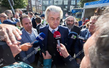 Dutch right-wing populist 'Partij voor de Vrijheid' (Party for the Freedom) leader Geert Wilders (C) speaks to the media during a visit with Flemish far-right 'Vlaams Belang' party' Filip Dewinter (not pictured), in Antwerp, Belgium, 02 September 2018. Wilders announced on 30 August that he was cancelling the Prophet Muhammad cartoon competition, scheduled to be held in autumn, over security concerns.