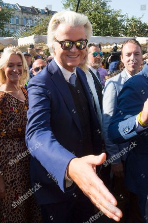 Dutch right-wing populist 'Partij voor de Vrijheid' (Party for the Freedom) leader Geert Wilders (C) greets supporters during a visit with Flemish far-right 'Vlaams Belang' party' Filip Dewinter (not pictured), in Antwerp, Belgium, 02 September 2018. Wilders announced on 30 August that he was cancelling the Prophet Muhammad cartoon competition, scheduled to be held in autumn, over security concerns.