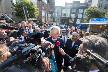 Dutch right-wing populist 'Partij voor de Vrijheid' (Party for the Freedom) leader Geert Wilders (C) speaks to the lmedia during a visit with Flemish far-right 'Vlaams Belang' party' Filip Dewinter (not pictured), in Antwerp, Belgium, 02 September 2018. Wilders announced on 30 August that he was cancelling the Prophet Muhammad cartoon competition, scheduled to be held in autumn, over security concerns.