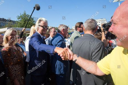 Dutch right-wing populist 'Partij voor de Vrijheid' (Party for the Freedom) leader Geert Wilders (2-L) greets a supporter during a visit with Flemish far-right 'Vlaams Belang' party' Filip Dewinter (C), in Antwerp, Belgium, 02 September 2018. Wilders announced on 30 August that he was cancelling the Prophet Muhammad cartoon competition, scheduled to be held in autumn, over security concerns.