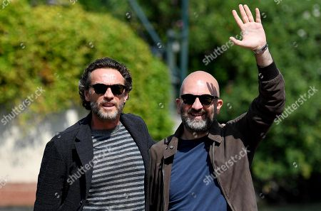 Italian actor Alessio Boni (L) and Italian writer Donato Carrisi arrive at the Lido Beach for the 75th annual Venice International Film Festival, in Venice, Italy, 02 September 2018. The festival runs from 29 August to 08 September.
