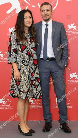 Italian film firector Roberto Minervini and producer Denise Ping Lee pose during a photocall for 'What you gonna do when the world's on fire?' during the 75th annual Venice International Film Festival, in Venice, Italy, 02 September 2018. The movie is presented in the official competition 'Venezia 75' at the festival running from 29 August to 08 September 2018.