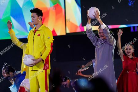 Jack Ma (R), the founder and executive chairman of Chinese e-commerce company Alibaba Group, and Chinese swimmer Sun Yang perform a presentation for the 19th Asian Games Hangzhou 2022 during the closing ceremony of the Asian Games 2018 at the Gelora Bung Karno Main Stadium in Jakarta, Indonesia, 02 September 2018.