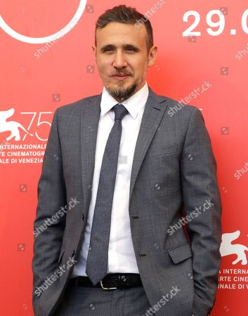 Director Roberto Minervini poses for photographers at the photo call for the film 'What You Gonna Do When The World's On Fire' at the 75th edition of the Venice Film Festival in Venice, Italy