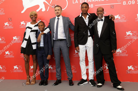 Actors Judy Hill, left, Titus Turner, second left, director Roberto Minervini, centre, and actors Kevin Goodman, second right, and Ronaldo King, right, pose for photographers at the photo call for the film 'What You Gonna Do When The World's On Fire' at the 75th edition of the Venice Film Festival in Venice, Italy