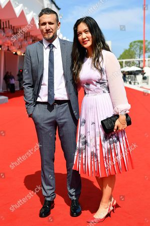 Italian director Roberto Minervini and producer Denise Ping Lee (R) arrive for the premiere of 'What you gonna do when the world's on fire?' during the 75th annual Venice International Film Festival, in Venice, Italy, 02 September 2018. The movie is presented in the official competition 'Venezia 75' at the festival running from 29 August to 08 September 2018.