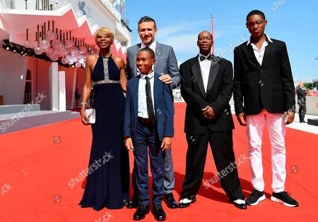From left, actress Judy Hill, director Roberto Minervini, actors Titus Turner, foreground, Kevin Goodman, and Ronaldo King, pose for photographers at the red carpet for the film 'What You Gonna Do When The World's On Fire' at the 75th edition of the Venice Film Festival in Venice, Italy