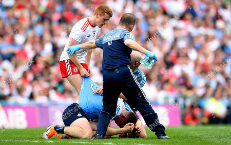 Dublin vs Tyrone. Dublin doctor Ciaran O Malley with John Small and Peter Harte of Tyrone