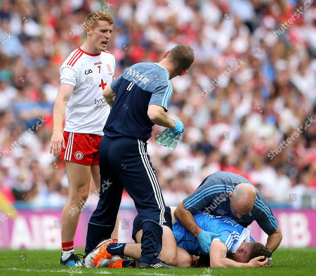 Stock Photo of Dublin vs Tyrone. Dublin doctor Ciaran O Malley with John Small and Peter Harte of Tyrone