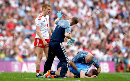 Stock Picture of Dublin vs Tyrone. Dublin doctor Ciaran O Malley with John Small and Peter Harte of Tyrone