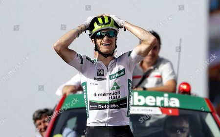Stock Photo of US rider Benjamin King of Dimension Data team reacts as he wins the 9th stage of La Vuelta 2018 cycling tour, over 200.8 km between Talavera de la Reina and La Covatilla, Salamanca, Spain, 02 September 2018.