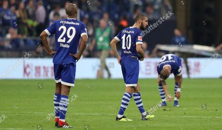 Schalke's Naldo, Schalke's Nabil Bentaleb and SchalkeÕs Guido Burgstaller reacts after the German Bundesliga soccer match between FC Schalke 04 and Hertha BSC Berlin in Gelsenkirchen, Germany, 02 September 2018.